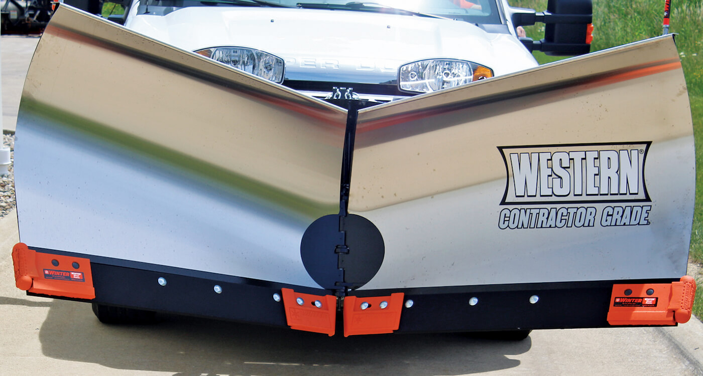 silver v-shaped snow plow blade on front of a pickup truck