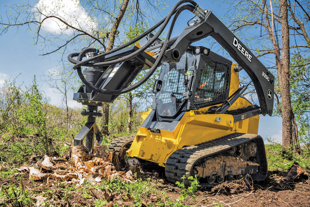 skid steer with an attachment to handle tree stumps