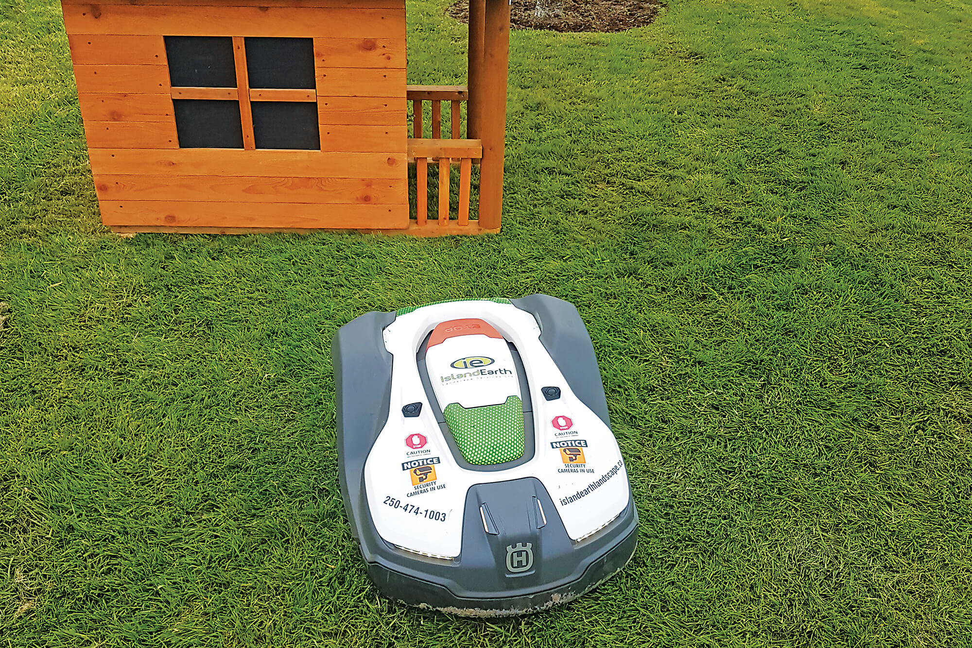robotic mower in front of an obstacle
